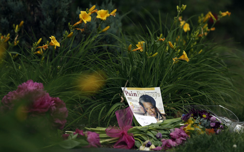 A memorial is shown outside a gate at the home of Maya Angelou in Winston-Salem, N.C., Wednesday, May 28, 2014. Angelou, a Renaissance woman and cultural pioneer, died Wake Forest University said in a statement Wednesday, May 28, 2014. She was 86. (AP Photo/Gerry Broome)