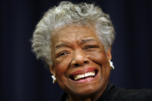 """FILE - In this Nov. 21, 2008 file photo, poet Maya Angelou smiles at an event in Washington. Angelou, author of """"I Know Why the Caged Bird Sings,"""" has died, Wake Forest University said Wednesday, May 28, 2014.  She was 86.  (AP Photo/Gerald Herbert, File)"""