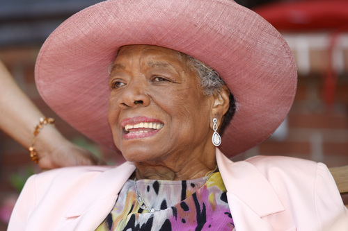 """FILE - In this May 20, 2010, file photo, author Maya Angelou socializes during a garden party at her home in Winston-Salem, N.C. Angelou, author of """"I Know Why the Caged Bird Sings,"""" has died, Wake Forest University said Wednesday, May 28, 2014.  She was 86.  (AP Photo/Nell Redmond, File)"""