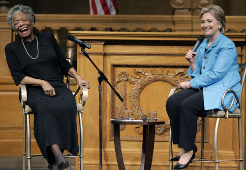 FILE - In this April 18, 2008 file photo, then U.S. Sen. Hillary Rodham Clinton, D-N.Y., right, speaks as poet Maya Angelou reacts during a campaign stop at Wake Forest University in Winston-Salem, N.C. Angelou, who rose from poverty, segregation and violence to become a force on stage, screen and the printed page, has died, Wake Forest University said Wednesday, May 28, 2014.  She was 86.  (AP Photo/Chuck Burton, File)