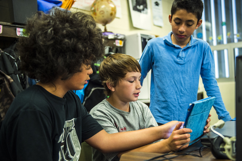 Chris Detrick  |  The Salt Lake Tribune Elijah Lose, left, Kobe Slack, center, and Fernelly Aguilar use an iPad to help learn about American history during Amber Palmer's class at Bennion Elementary School Tuesday May 6, 2014.