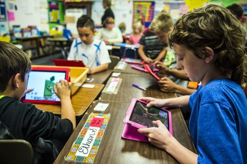 Chris Detrick  |  The Salt Lake Tribune Ethan Stevens, right, Isaac Burt, left, and Carson Davis, center, use iPads to help learn about American history during Amber Palmer's class at Bennion Elementary School Tuesday May 6, 2014.