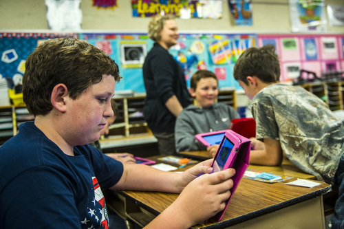 Chris Detrick  |  The Salt Lake Tribune Sky Lake-Allen, left, Braxton Bates, center, and Tucker York use iPads to help learn about American history during Amber Palmer's class at Bennion Elementary School Tuesday May 6, 2014.