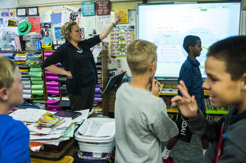 Chris Detrick  |  The Salt Lake Tribune Fifth grade teacher Amber Palmer works with Ty Kleinman, left, Kadin Flinn, Salman Ali and Alizon Ramos during class at Bennion Elementary School Tuesday May 6, 2014.