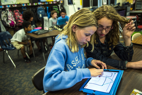 Chris Detrick  |  The Salt Lake Tribune Kynslie Ballamis, left, and Jade Torbeck use an iPad to help learn about American history during Amber Palmer's class at Bennion Elementary School Tuesday May 6, 2014.