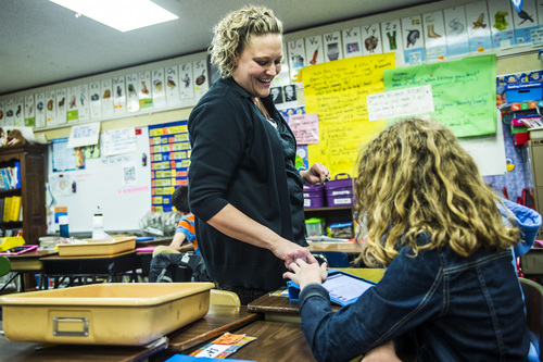 Chris Detrick  |  The Salt Lake Tribune Fifth-grade teacher Amber Palmer talks with Jade Torbeck during class at Bennion Elementary School Tuesday May 6, 2014.