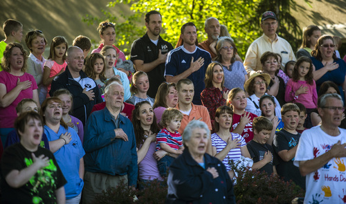 Chris Detrick  |  The Salt Lake Tribune Residents recite the Pledge of Allegiance during a Memorial Day celebration at Hogan Park in Woods Cross on Monday, May 26, 2014.