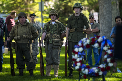 Chris Detrick  |  The Salt Lake Tribune World War II and Vietnam War Reenactors Chip Guarente, Aaron Bjelka and Ben Johnson listen during a Memorial Day service at Fort Douglas Cemetery  Monday May 26, 2014.