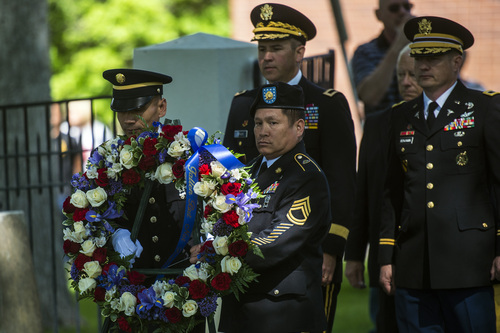 Chris Detrick  |  The Salt Lake Tribune Santi Khoundet, HHC 2nd Brigade, and Max Padua, 91st Training Division, carry a wreath during a Memorial Day service at Fort Douglas Cemetery  Monday May 26, 2014.