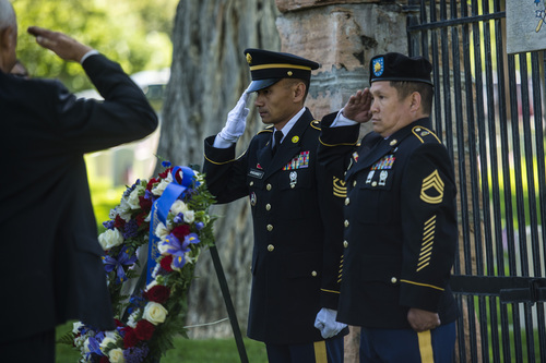 Chris Detrick  |  The Salt Lake Tribune Santi Khoundet, HHC 2nd Brigade, and Max Padua, 91st Training Division, salute a wreath during a Memorial Day service at Fort Douglas Cemetery  Monday May 26, 2014.