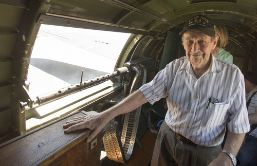 "Rick Egan  |  The Salt Lake Tribune  World War Two veteran Sam Wyrouck takes a flight in the ""Memphis  Belle,"" a restored WWII B-17 ""flying fortress"" bomber, for the first time since the war on May 26, 2014. Wyrouck flew in the B-17 as a lower ball turret gunner in World War II."