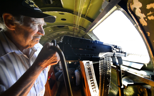 "Rick Egan  |  The Salt Lake Tribune  World War Two veteran Sam Wyrouck looks though the sight of a machine gun as he a takes a flight in the ""Memphis  Belle,"" a restored WWII B-17 ""flying fortress"" bomber on May 26, 2014.  Wyrouck flew in the B-17 as a lower ball turret gunner in World War II. This was his first flight in a B-17 since the war."