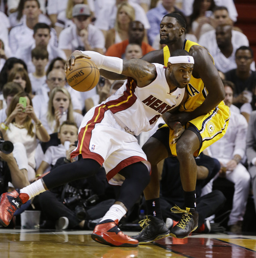 Indiana Pacers guard Lance Stephenson, right, defends Miami Heat forward LeBron James during the first half of Game 3 in the NBA basketball Eastern Conference finals playoff series, Saturday, May 24, 2014, in Miami. (AP Photo/Lynne Sladky)