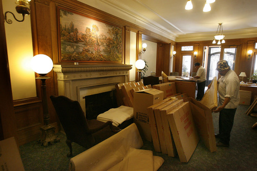 Movers packed paintings and furnishings into boxes in the main lobby of the Wall Mansion as the LDS Business College moved out in 2006. The building was donated to the University of Utah Tuesday. Tribune file photo.