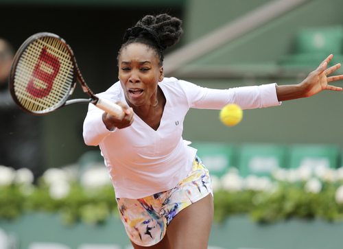Venus Williams of the U.S, returns the ball to Slovakia's Anna Schmiedlova during the second round match of  the French Open tennis tournament at the Roland Garros stadium, in Paris, France, Wednesday, May 28, 2014. (AP Photo/David Vincent)