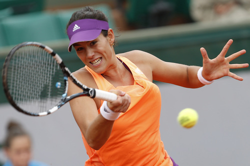 Spain's Garbine Muguruza returns the ball during the second round match of the French Open tennis tournament against Serena Williams of the U.S. at the Roland Garros stadium, in Paris, France, Wednesday, May 28, 2014. (AP Photo/Darko Vojinovic)