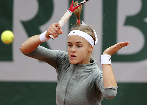 Slovakia's Anna Schmiedlova returns the ball during the second round match of the French Open tennis tournament against Venus Williams of the U.S. at the Roland Garros stadium, in Paris, France, Wednesday, May 28, 2014. (AP Photo/David Vincent)