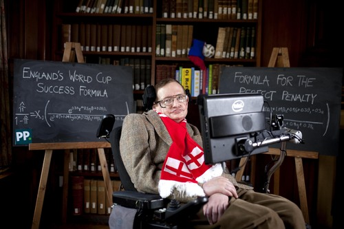 British Professor Stephen Hawking unveils a new scientific formula to predict the chances of England succeeding in the World Cup, in Cambridge, England, Wednesday, May 28, 2014. Stephen Hawking has turned his brilliant mind toward perhaps his toughest challenge yet _ helping England win the World Cup. Britain's most famous scientist, known for his theories on physics and the universe, has been commissioned by a betting company to analyze data from every World Cup England has qualified for since winning the tournament in 1966 in the hopes of coming up with a winning formula. (AP Photo/David Parry/PA) UNITED KINGDOM OUT NO SALES NO ARCHIVE PHOTOGRAPH CAN NOT BE STORED OR USED FOR MORE THAN 14 DAYS AFTER THE DAY OF TRANSMISSION