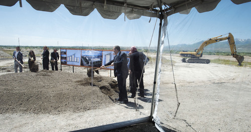Steve Griffin  |  The Salt Lake Tribune  Dignitaries turn shovels of dirt during ground breaking ceremony for the new 23 million-square-foot industrial storage, warehousing and distribution center directly west of Rocky Mountain Raceway in West Valley City Thursday, May 29, 2014.
