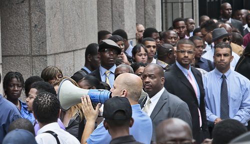 FILE - In this  Thursday, Aug. 8, 2013, file photo, Applicants listen to a speaker's bull horn instructions for attending a combined Metropolitan Transportation Authority (MTA) and Harlem Week job and career fair at Columbia University in New York. The Labor Department reports the number of people who applied for unemployment benefits last week later Thursday May 29, 2014. (AP Photo/Bebeto Matthews, File)