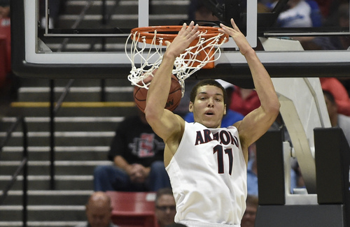 Arizona forward Aaron Gordon puts in a reverse dunk against Weber State during the first half in a second-round game in the NCAA college basketball tournament Friday, March 21, 2014, in San Diego. (AP Photo/Denis Poroy)