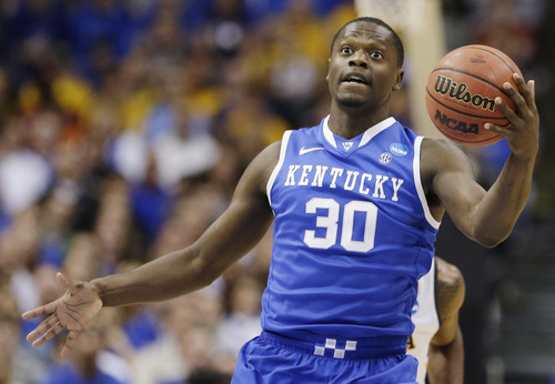 Kentucky forward Julius Randle (30) grabs the ball against Wichita State during the first half of a third-round game of the NCAA college basketball tournament Sunday, March 23, 2014, in St. Louis. (AP Photo/Charlie Riedel)