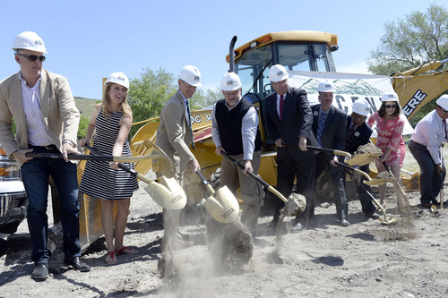 Al Hartmann  |  The Salt Lake Tribune Salt Lake City and Salt Lake Library officials shovel dirt in a groundbreaking ceremony for the new Marmalade Branch of the Salt Lake City Public Library Thursday, May 29.   The future site of the building is now an open block on the corner of 500 North and 300 West. The construction is expected to be completed in the summer of 2015.