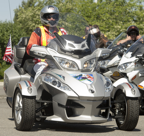Rick Egan  |  The Salt Lake Tribune  Sande Kellog rides her Can-Am Spyder along with members of the Utah Highway Patrol, and other police agencies and civilian riders  rally in local news media outlet parking lots to share the latest tools aimed at reducing Utah motorcycle fatalities, Thursday, May 29, 2014
