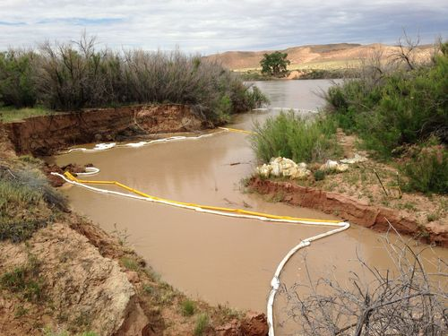 Courtesy photo | Bureau of Land Management  Crews work to clean up damage from a leaking oil well in the Salt Wash field, about 12 miles southeast of Green River.