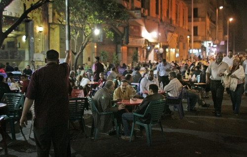 FILE - In this file photo dated Friday, Oct. 31, 2008, customers of all shapes and sizes sit at street cafes in central Cairo, Egypt.  Almost a third of the world population is now fat, and no country has been able to curb obesity rates in the last three decades, according to a new global analysis released Thursday May 29, 2014, led by Christopher Murray of the Institute for Health Metrics and Evaluation at the University of Washington, USA, and paid for by the Bill & Melinda Gates Foundation.  Researchers reviewed more than 1,700 studies covering 188 countries covering over three decades and found more than 2 billion people worldwide classified as overweight or obese. The highest rates of obesity were found in the Middle East and North Africa, with the U.S. having about 13 percent of the world's fat population.(AP Photo/Ben Curtis, FILE)