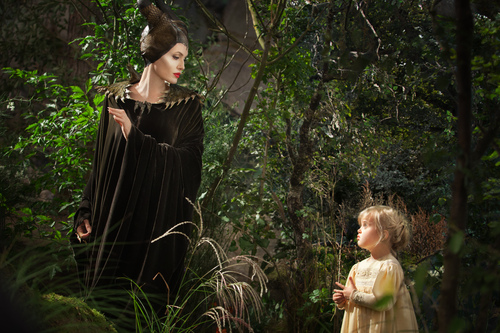 """This image released by Disney shows Angelina Jolie as Maleficent, left, in a scene with her daughter Vivienne Jolie-Pitt, portraying Young Aurora, in a scene from  """"Maleficent."""" (AP Photo/Disney, Frank Connor)"""