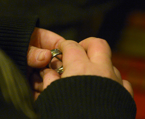 Steve Griffin  |  The Salt Lake Tribune   Kristan Frahm, of Clinton, holds her wedding rings as she waits in line to get married, with her wife, Rachel Frahm at the Hampton Inn Suites in Ogden, Utah Monday, December 23, 2013. Volunteer clergy were performing marriage ceremonies for couples across the street from the Weber County Clerk's Office in downtown Ogden.