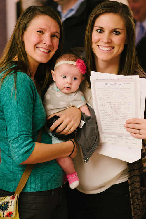 (Candice Green courtesy photo) Candice Green Berret (left) and Megan Berret, with their baby, Quinn, were married Friday after a federal judge struck down Utah's constitutional amendment and laws preventing same-sex marriage.