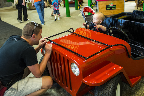 Chris Detrick     The Salt Lake Tribune Jon Jepsen and his son, Atticus Goddard, 15 months, play on a toy Jeep at Discovery Gateway Children's Museum on Thursday. Utah Unites for Marriage, Discovery Gateway Childrenís Museum and Equality Utah hosted a free night at the museum to give parents and kids an entertaining evening to celebrate all families.