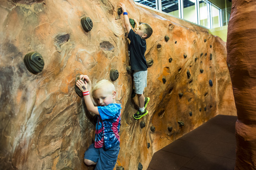 Chris Detrick     The Salt Lake Tribune Eli Hoffman, 3, and Paul Hoffman, 5, of Salt Lake City, climb a rock wall at Discovery Gateway Children's Museum Thursday May 29, 2014. Utah Unites for Marriage, Discovery Gateway Children's Museum and Equality Utah hosted a free night at the museum to give parents and kids an entertaining evening to celebrate all families.
