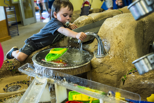 Chris Detrick     The Salt Lake Tribune Quinn Dunlop, 2, of Salt Lake City, plays in the water feature at Discovery Gateway Children's Museum Thursday May 29, 2014. Utah Unites for Marriage, Discovery Gateway Children's Museum and Equality Utah hosted a free night at the museum to give parents and kids an entertaining evening to celebrate all families.