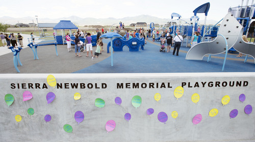 Steve Griffin  |  The Salt Lake Tribune   People play in the playground during the grand opening of the Sierra Newbold Playground in West Jordan, Utah Friday, May 30, 2014. The playground is named after the 6-year-old girl who was abducted from her home on June 26, 2012, and killed. The new playground is part of the Ron Wood Park, which is named after a West Jordan police officer who was shot and killed Nov. 18, 2002, by a 16-year-old suspect wanted in connection with a string of burglaries. When all phases are complete, the park will total about 64 acres.