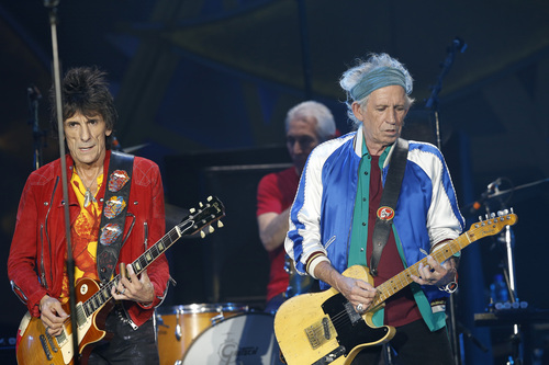 Members of The Rolling Stones with Keith Richards, guitar right, and drummer Charlie Watts, obscured centre, with Ronnie Wood, guitar left, perform during a concert in the Telenor Arena at Fornebu in Baerum just south of Oslo, Norway, Monday May 26, 2014. The Stones rock combo are on a world wide tour billed as The Rolling Stones On Fire.  (AP Photo / Terje Bendiksby, NTB Scanpix) NORWAY OUT