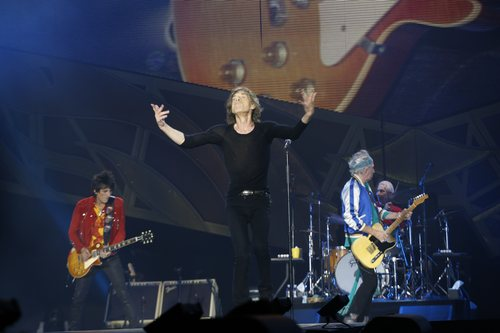 Rolling Stones singer front man Mick Jagger, centre, with Keith Richards, guitar right, drummer Charlie Watts, obscured right, and with Ronnie Wood, guitar left, perform during a concert in the Telenor Arena at Fornebu in Baerum just south of Oslo, Norway, Monday May 26, 2014. The Stones rock combo are on a world wide tour billed as The Rolling Stones On Fire.  (AP Photo / Terje Bendiksby, NTB Scanpix) NORWAY OUT