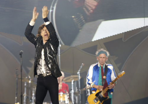 Rolling Stones singer front man Mick Jagger, left, with Keith Richards, right, and drummer Charlie Watts, obscured behind, perform during a concert in the Telenor Arena at Fornebu in Baerum just south of Oslo, Norway, Monday May 26, 2014. The Stones rock combo are on a world wide tour billed as The Rolling Stones On Fire.  (AP Photo / Terje Bendiksby, NTB Scanpix) NORWAY OUT
