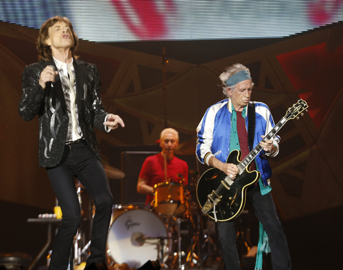 Rolling Stones singer front man Mick Jagger, left, with Keith Richards, right, and drummer Charlie Watts, centre, perform during a concert in the Telenor Arena at Fornebu in Baerum just south of Oslo, Norway, Monday May 26, 2014. The Stones rock combo are on a world wide tour billed as The Rolling Stones On Fire.  (AP Photo / Terje Bendiksby, NTB Scanpix) NORWAY OUT