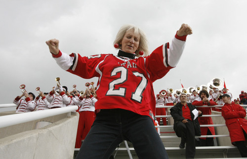"Rick Egan  |  Tribune file photo  ""Bubbles"", who fans sometimes call the ""Crazy Lady"", dances in the south bleachers between the 3 and 4th quarter during of a game against San Diego State in 2007."