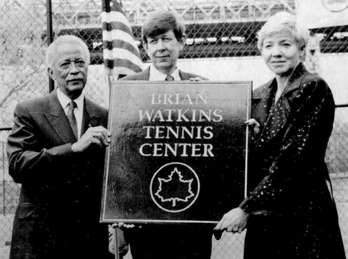 Tribune File Photo New York's Mayor David Dinkins, left, holds a plaque with Sherman and Karen Watkins of Provo, Utah, after a dedication ceremony at the Brian Watkins Tennis Center in New York. April 29, 1991.