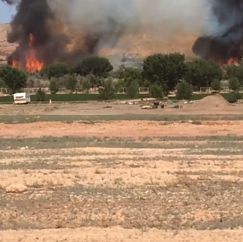 This screen capture of an Instagram video posted by Sen. Steve Urquhart shows a brush fire burning near St. George on June 02, 2014.