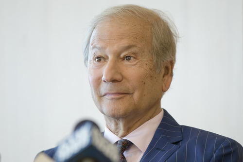 FILE - In this May 27, 2014 file photo, businessman Lewis Katz, left speaks at a news conference after a closed-door auction to buy the The Philadelphia Inquirer and Philadelphia Daily News in Philadelphia.  The editor of The Philadelphia Inquirer says co-owner Lewis Katz is among the seven people killed in a plane crash in Massachusetts.  Bill Marimow confirmed Katz's death to Philly.com on Sunday, June 1, 2014 saying he learned the news from close associates.  The plane crashed and caught fire as it was leaving Hanscom Field while on its way to Atlantic City International Airport. Massachusetts Port Authority spokesman Matthew Brelis says there were no survivors in the crash.   (AP Photo/Matt Rourke)