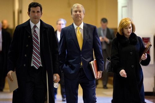 FILE - In this Nov. 13, 2013 file photo, businessman and co-owner of The Philadelphia Inquirer Lewis Katz, center, walks to Judge Patricia McInerney's courtroom  at City Hall in Philadelphia.  The editor of The Philadelphia Inquirer says co-owner Lewis Katz is among the seven people killed in a plane crash in Massachusetts.  Bill Marimow confirmed Katz's death to Philly.com on Sunday, June 1, 2014 saying he learned the news from close associates.  The plane crashed and caught fire as it was leaving Hanscom Field while on its way to Atlantic City International Airport. Massachusetts Port Authority spokesman Matthew Brelis says there were no survivors in the crash.  (AP Photo/Matt Rourke)