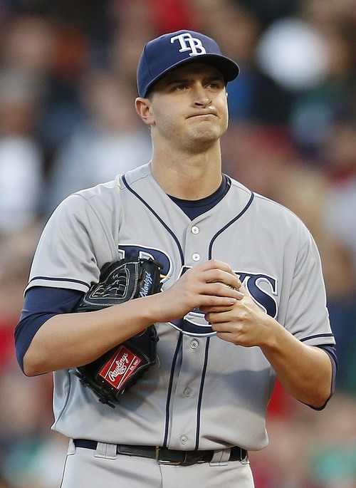 Tampa Bay Rays' Jake Odorizzi reacts after hitting Boston Red Sox's Mike Carp with a pitch in the second inning of a baseball game in Boston, Saturday, May 31, 2014. (AP Photo/Michael Dwyer)