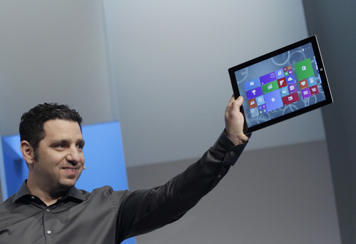 Mark Lennihan  |  The Associated Press Panos Panay, Microsoft's vice president for surface computing, introduces the Surface Pro 3 tablet device at a media preview on May 20 in New York City. The device has a screen measuring 12 inches diagonally, up from 10.6 inches in previous models. Microsoft says it's also thinner and faster than before.