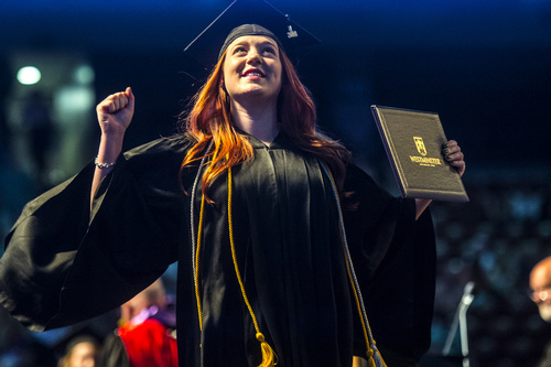 Chris Detrick  |  The Salt Lake Tribune Aimée D'Ann Green celebrates after receiving her diploma during Westminster College's Commencement at the Maverik Center Saturday May 31, 2014. 977 students graduated. Green graduated Cum Laude with a bachelor of science in accounting.