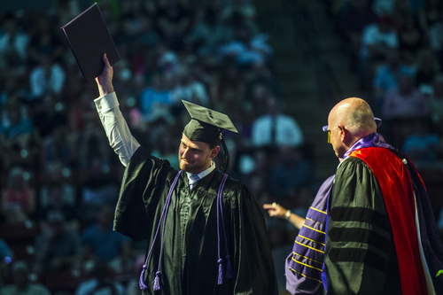 Chris Detrick  |  The Salt Lake Tribune Brett Johnson celebrates after receiving his diploma during Westminster College's Commencement at the Maverik Center Saturday May 31, 2014. 977 students graduated.